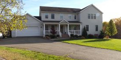 A huge newer country home with acreage and privacy.