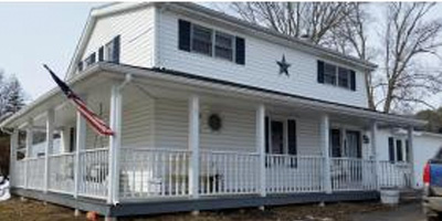 A great country home with sitting porches and large outbuildings.