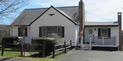 A spacious Cape Cod with a large yard and outbuildings. Close to BU!