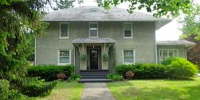 A stately 1920s home full of rich and ornate woodwork and a new gourmet kitchen.