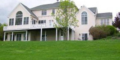 An expansive bed and breakfast, overlooking a golf course, with up to 9 beds and 10 baths.