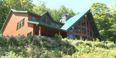 A spectacular Contemporary overlooking the Whitney Point Reservoir.