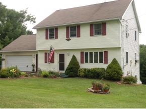 A 1-owner country home on 8 acres near Chenango Valley State Park.