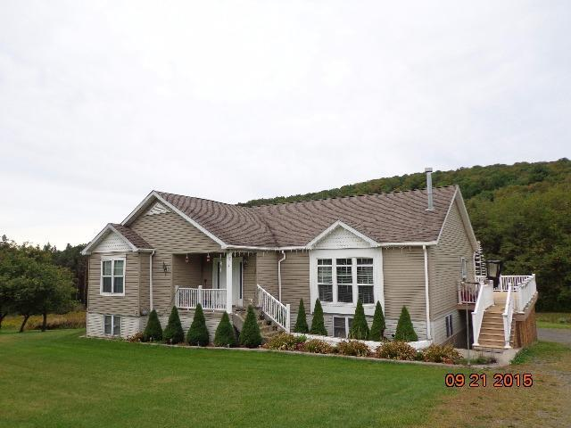 A beautiful custom-built one-owner home just a couple miles from Onetona.