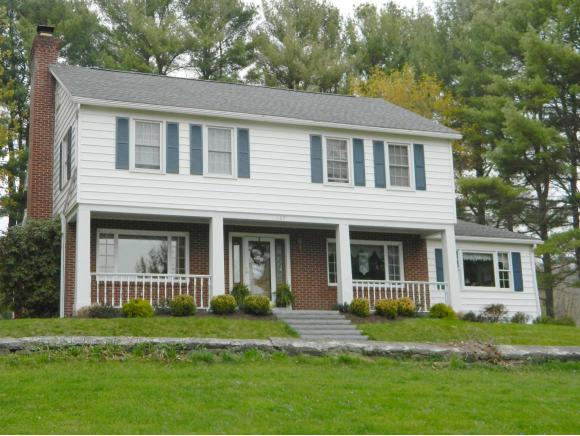 A lovely 2-story on acreage with level lawns.