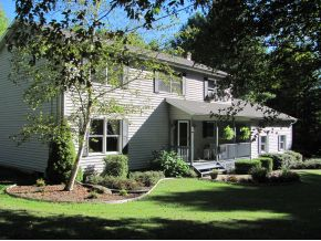 An updated 2-story home on 10 private acres.