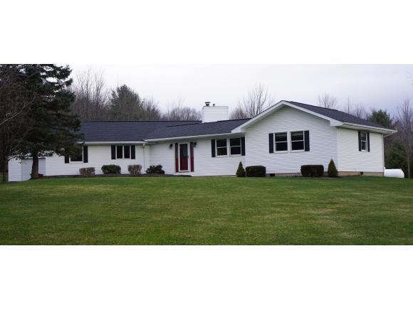 An updated and expanded Ranch on 2.5 acres.