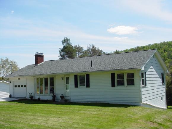 A full updated and renovated Ranch on a scenic acre.