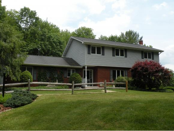 A spectacular country estate with an updated home and horse barn.