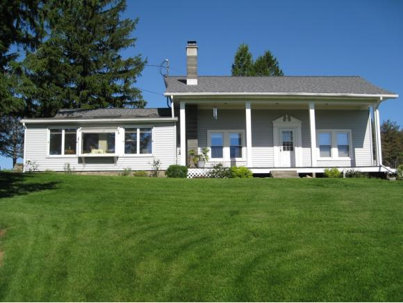A unique country property featuring a fully renovated home along with 2 great outbuildings