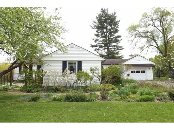A lovely ranch home on a half acre full of mature gardens and beautiful courtyards.