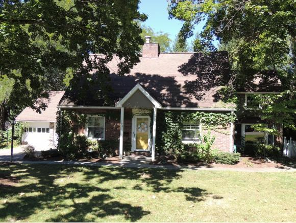 A picturesque cottage-style home with a gourmet kitchen and private yard.