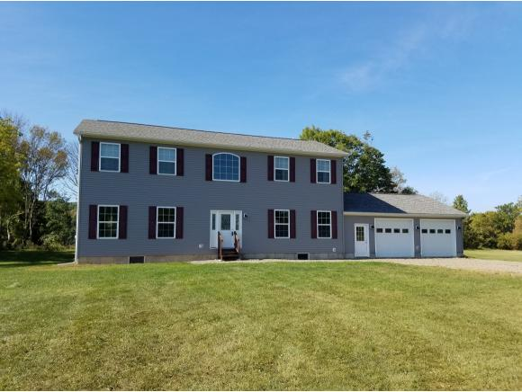 A huge Colonial built in 2014 with contemporary spaces and level acreage.