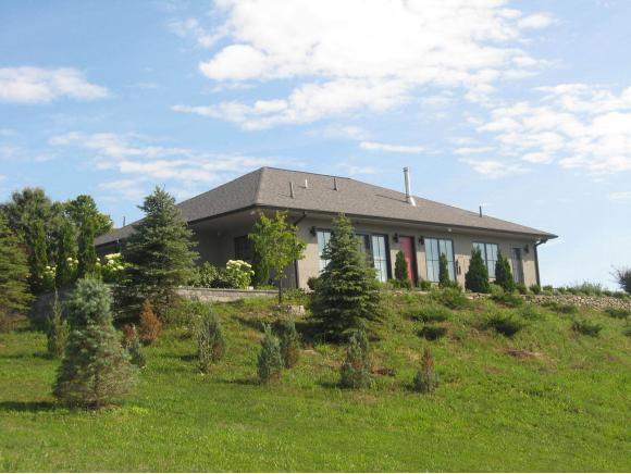 A custom-built luxurious home on acres and views for miles.