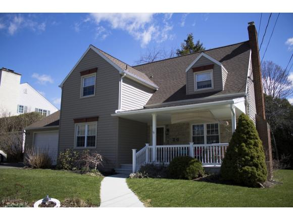 A stately 2-story on the West Side featuring newer roof, windows, kitchen, and many other updates.