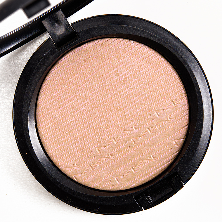 Mac Highlighter in Oh Darling - £25.50   Extra Dimension Skinfinish adds the perfect glow to skin. The liquid-powder highlighter, with prismatic reflections, is designed to sculpt and highlight your face, leaving a luminous, well-defined finish. The creamy powder formula lasts up to ten hours.