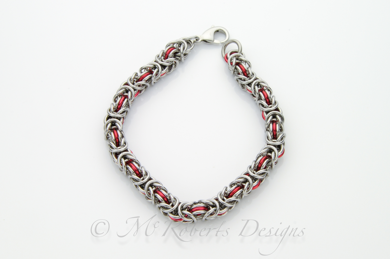 made with stanless steel and red anodized aluminum