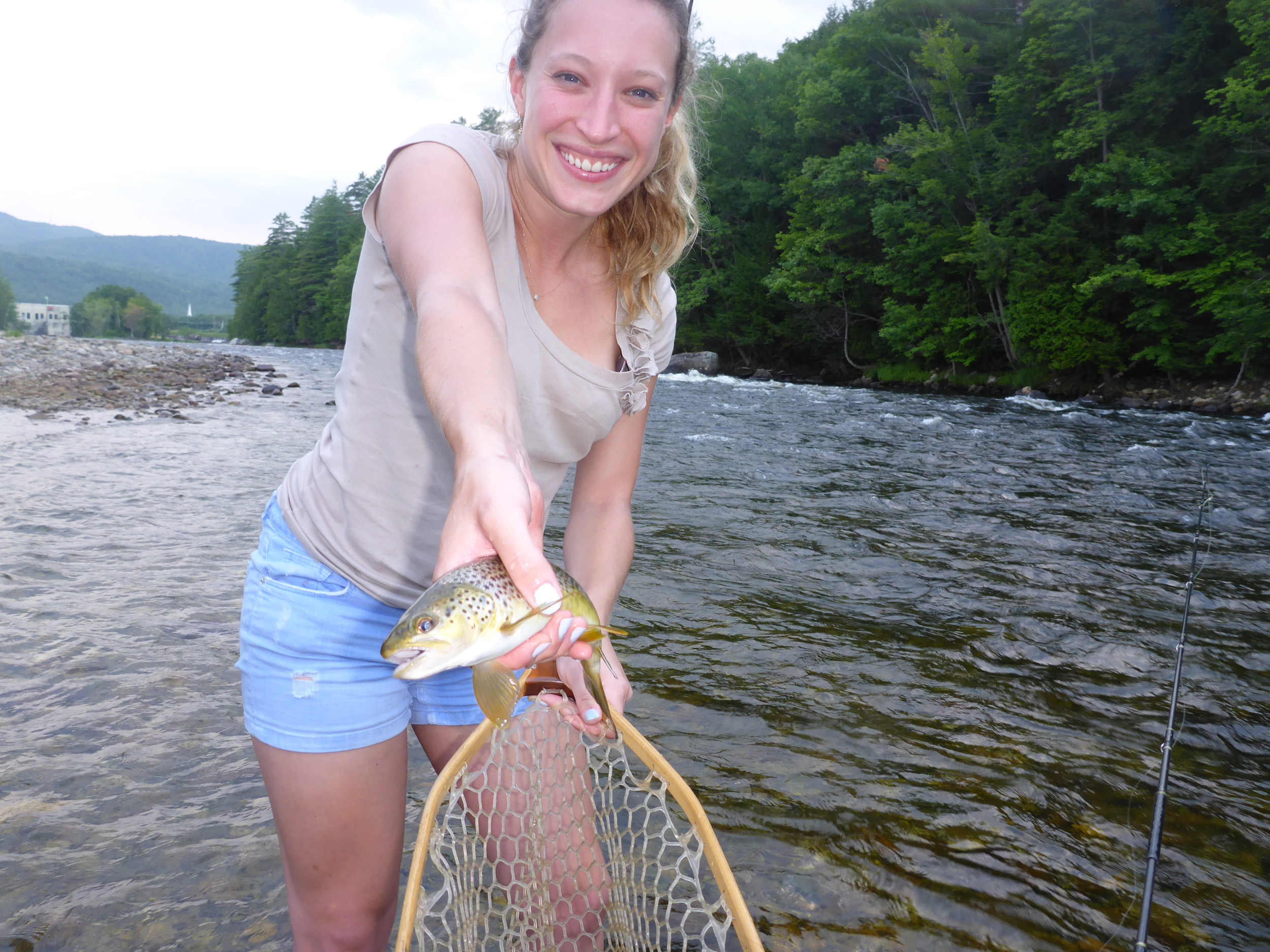 Emily with her first brown trout on the fly!
