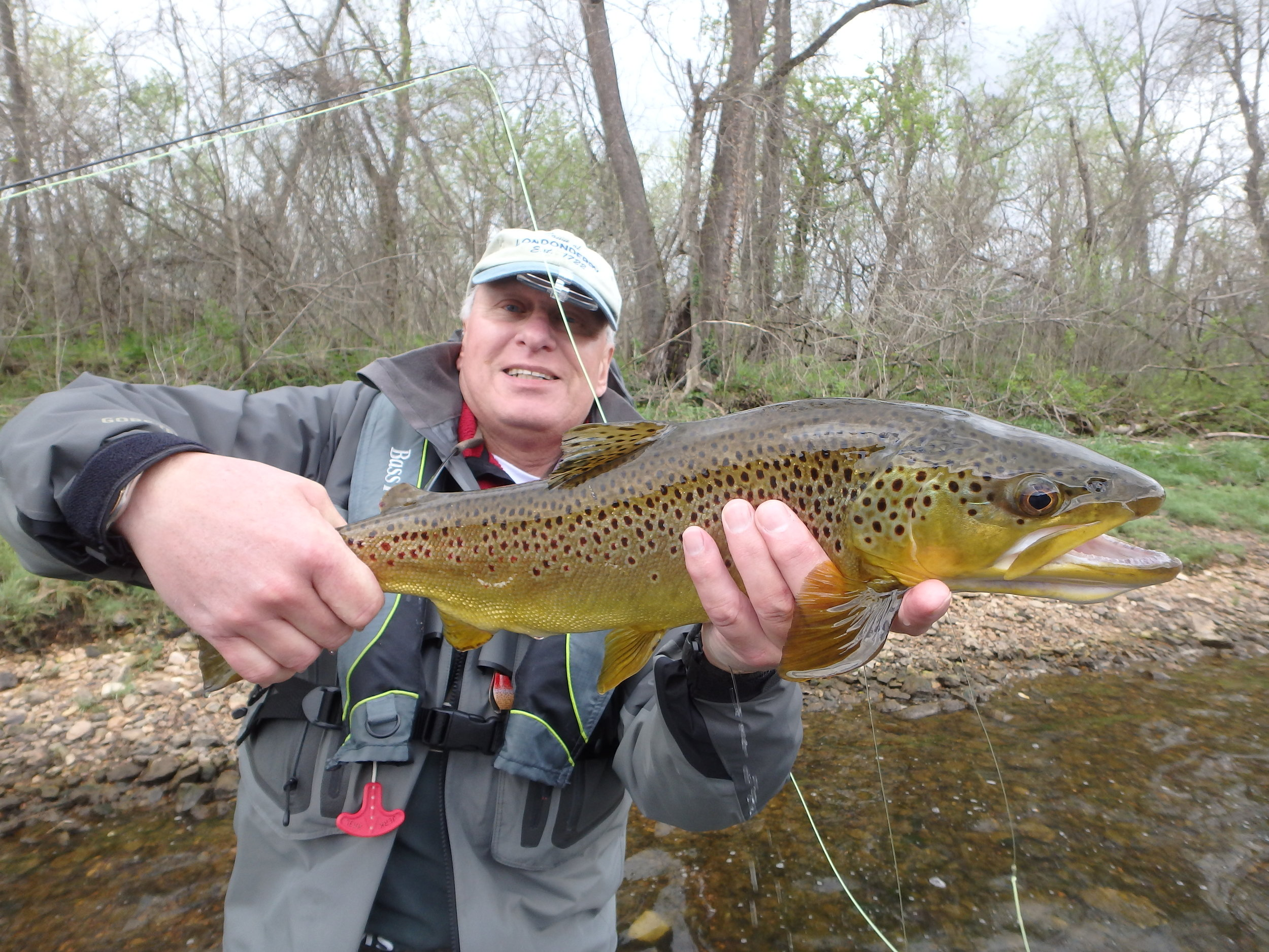Client Dick Peterson with a large brown that he finessed to the net on 5X!