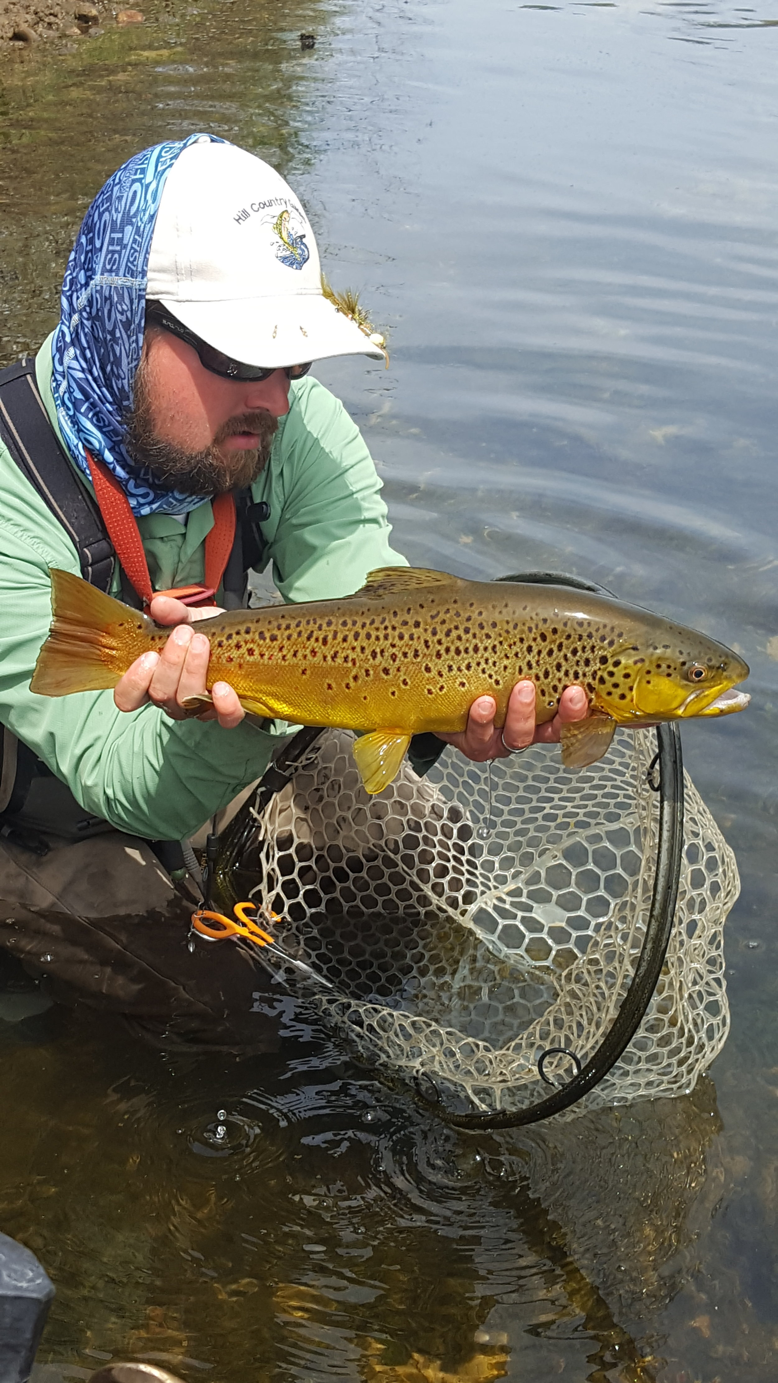 Nate Hill with one of many brown trout caught while fishing with Jeremy Hunt.
