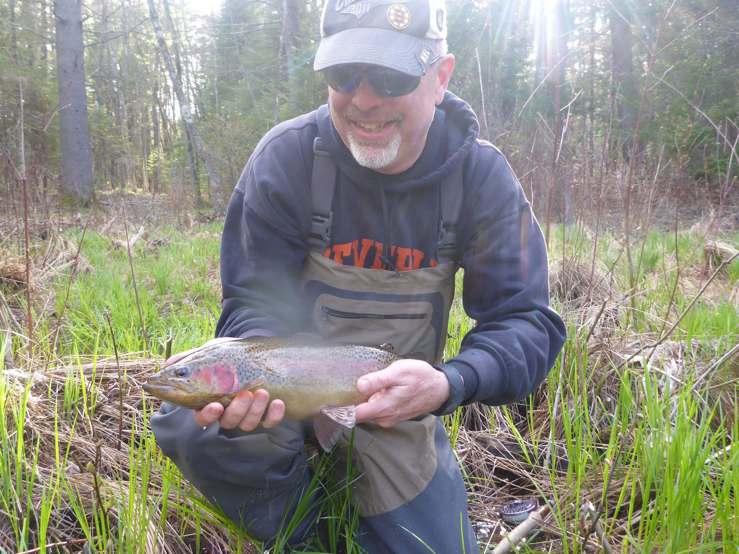 Client Michael Lewis with a large lake run rainbow Taken May 7th 2016.