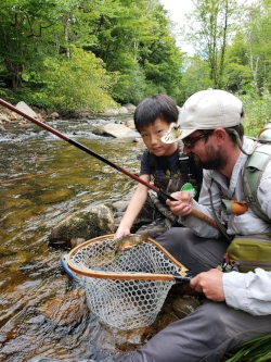 Hayden with his first trout on the fly...a buck male brook trout taken on the Red Brook One.