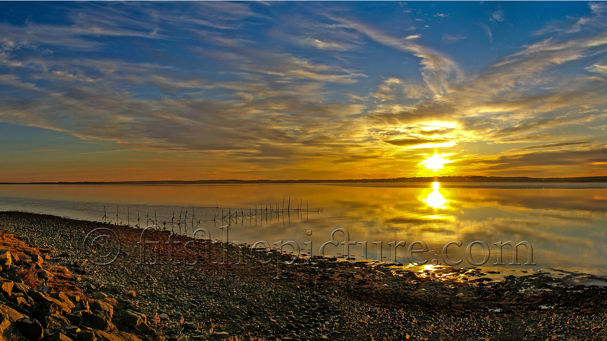 Cree Estuary salmon nets at sunset