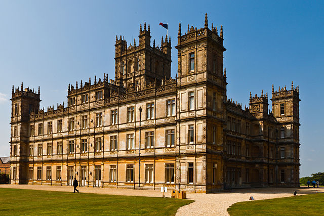 """Highclere Castle (April 2011)"" by Richard Munckton from Windsor, Melbourne, Australia - Downton Abbey (Highclere Castle). Licensed under CC BY 2.0 via Commons"