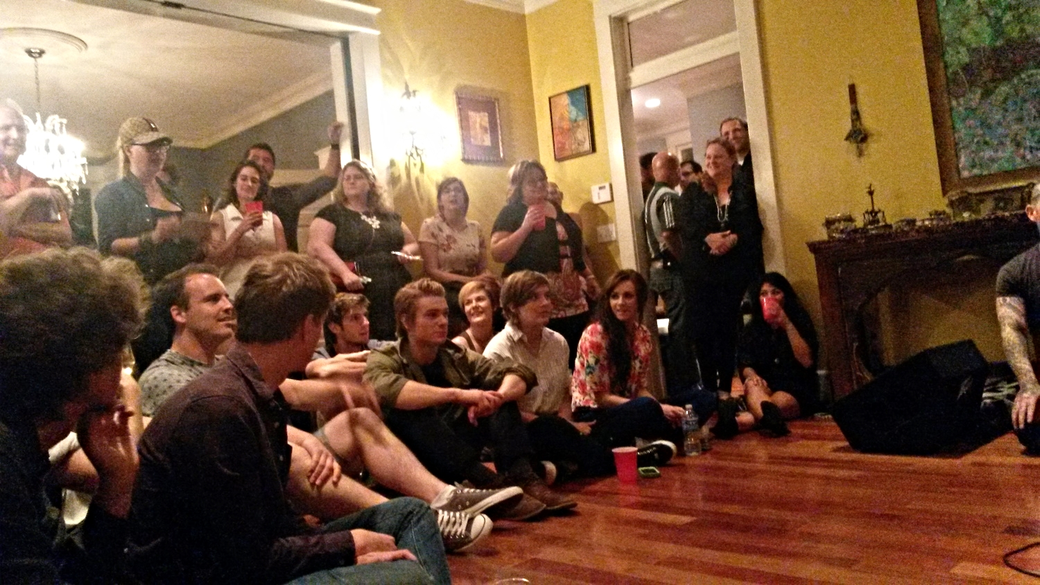 Everyone gathered round the speakers at the listening party.