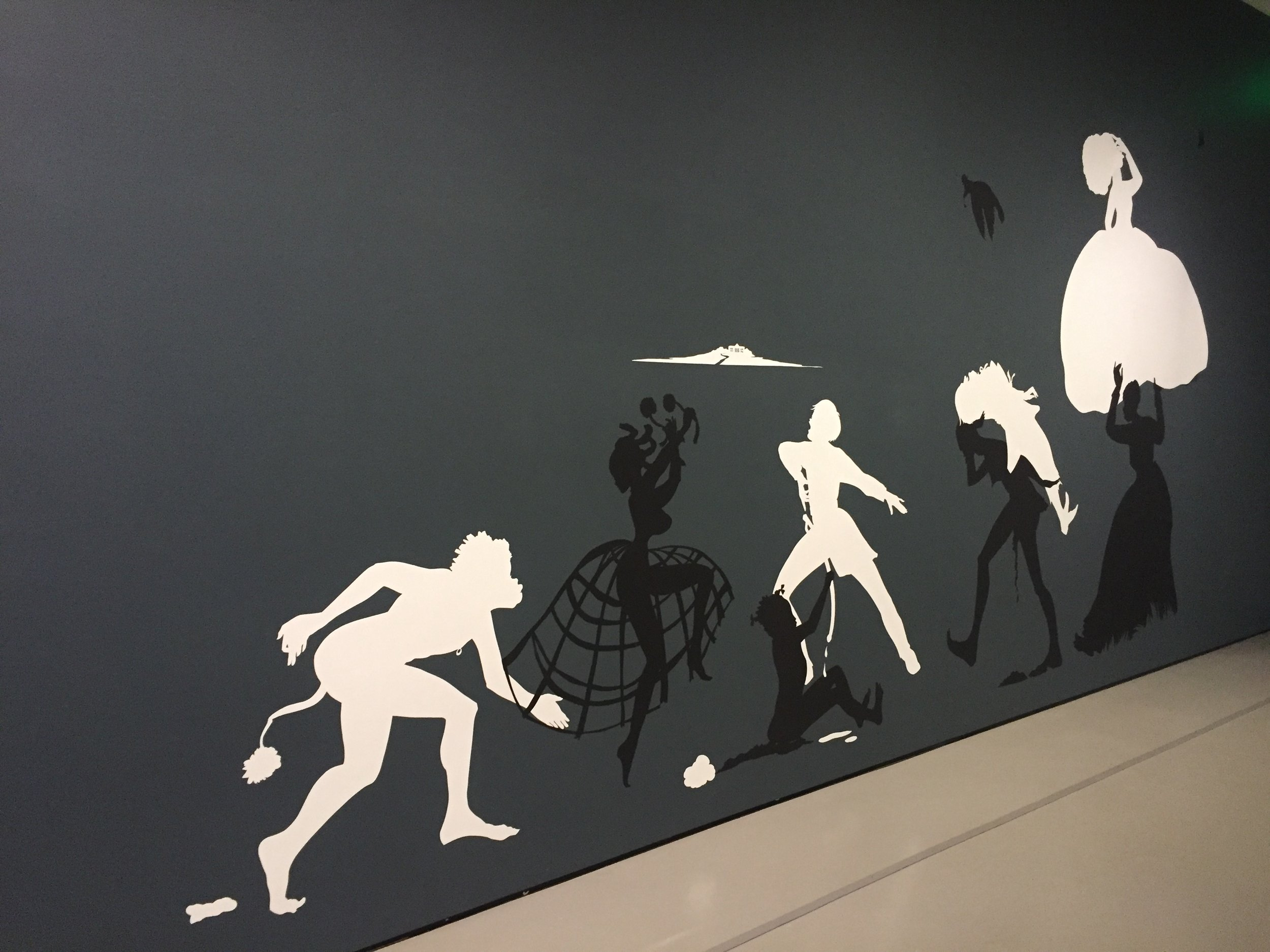 Kara Walker, The Rich Soil Down There, 2002, Cut paper and adhesive on painted wall