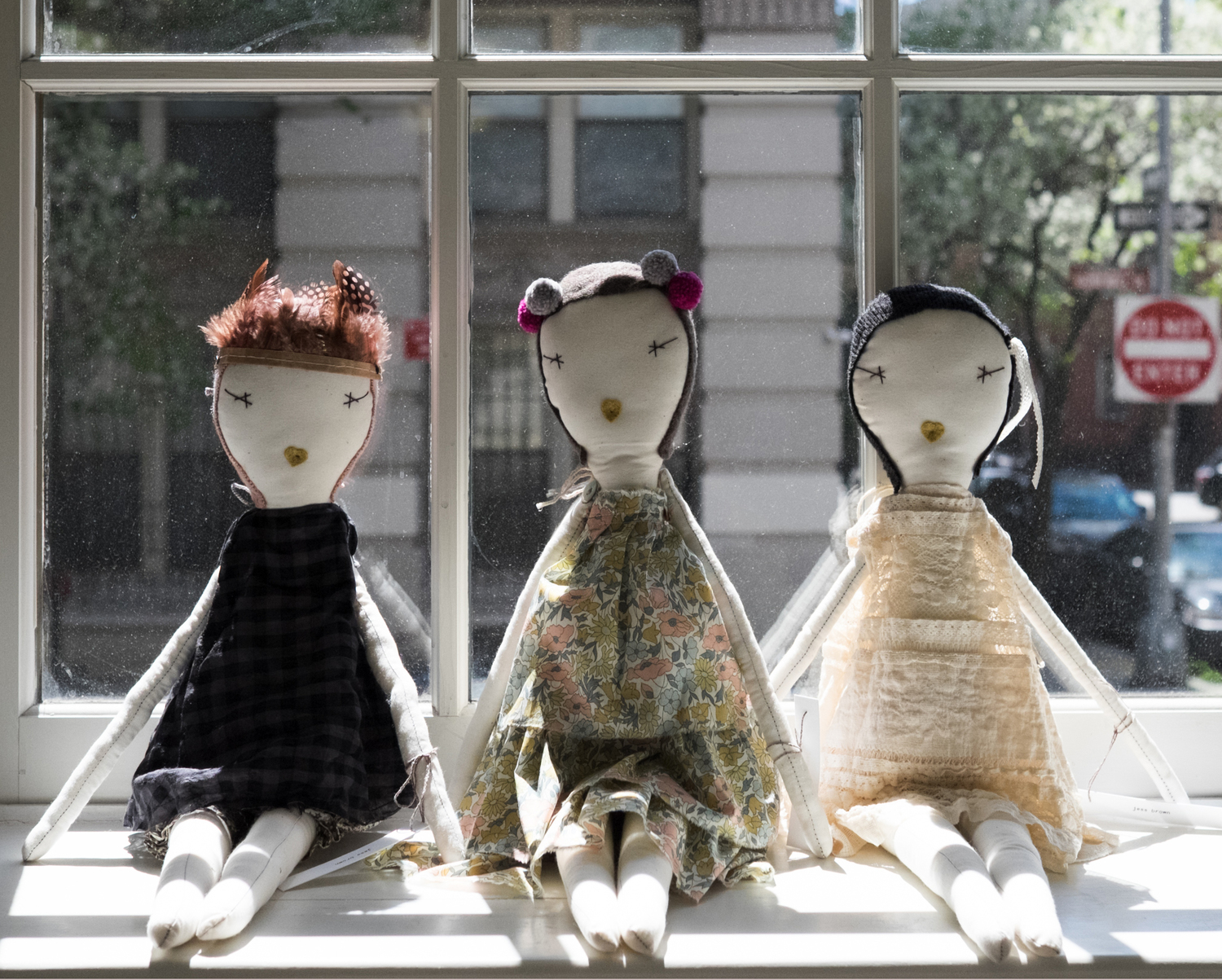Jess Brown  dolls sitting on the window cill at petiteSHOP: 27 Christopher Street, NYC. | Photos:  Laura Fontaine