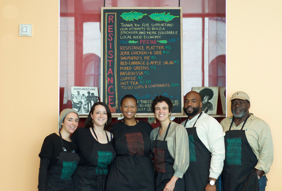 Resistance Menu chefs Ailbhe Pascal of  Fikira Bakery  (L), Sulaiha Olatunji of  PplFood , Taylor Johnson-Gordon of Sistah of the Yam, Kristin Schwab of PHL Assembled Kitchen, Gorman and Baldwin Bright of Epicurean Jerk Sauce. Aprons and table runners by artist  Oluwafemi . | Photo by Alex Jones Read more  here .