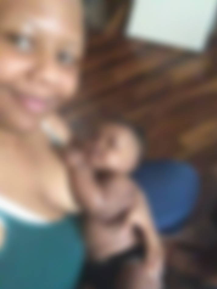 Me and my 5 month old daughter milk drunk after a feeding! Image is blurred for her privacy.