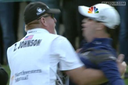 Chest bump. Zach Johnson celebrates his dramatic hole out for par.