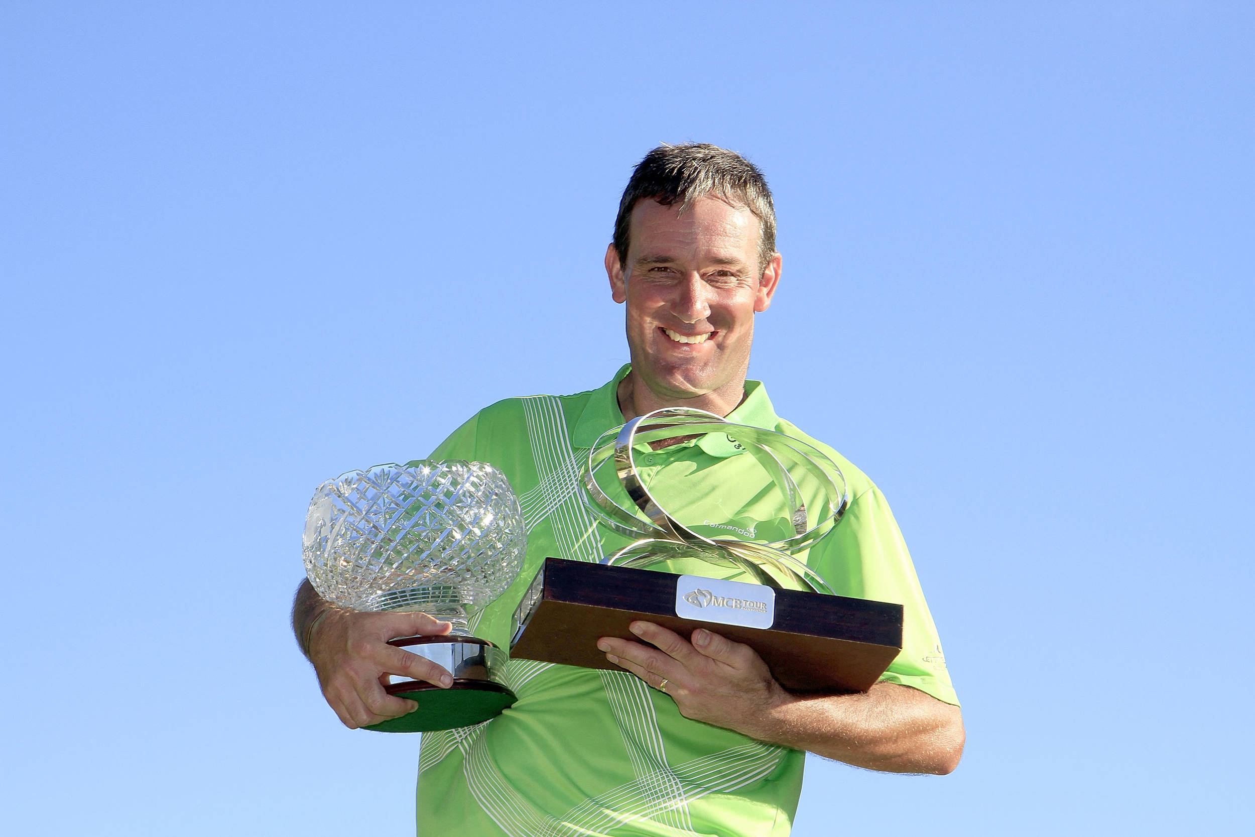 Paul Wesselingh with the MCB Tour Championship and the John Jacobs trophies. © Getty Images