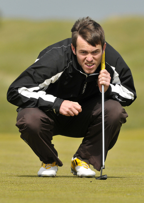 Aaron Kearney studies the line of a putt on the final day of the 2013 Irish Amateur Open at Royal Dublin. Picture: Pat Cashman / www.cashmanphotography.ie