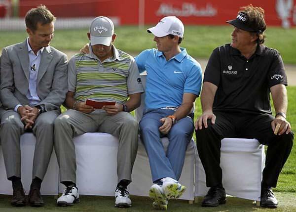 AP shot via  Golf.com  of a gracious Rory McIlroy congratulating Abu Dhabi winner Pablo Larrazabal as Phil Mickelson looks on.