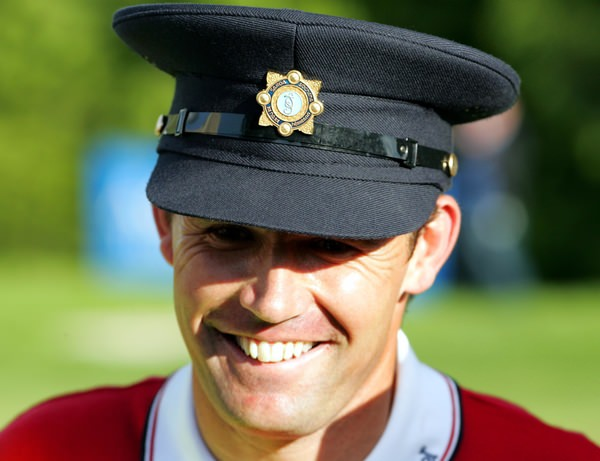 Pádraig Harrington donned a Garda's cap to celebrate his Irish Open win at Adare Manor in 2007. He'll be back in Munster for the Irish Open at Fota Island this year, hoping he's travelling there from the US Open. He is not yet qualified for the season's second major and doesn't rule out pre-qualifying at Walton Heath. PictureManus O'Reilly  www.golffile.ie