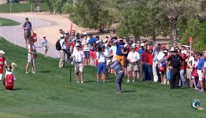 Rory McIlroy plays the shot that cost him a two shot penalty in Abu Dhabi.