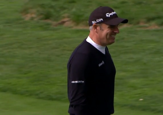 A happy Paul McGinley walks off the fifth green following his birdie two.