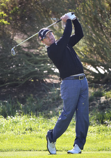 Graeme McDowell shows balance in Thursday's first round at Spyglass Hill.Picture: Kenneth E Dennis/ kendennisphoto.com