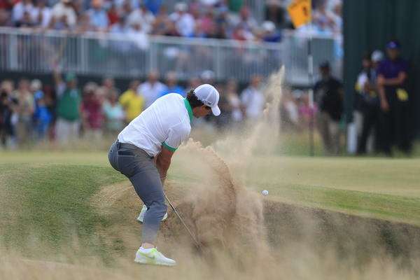 Rory McIlroy splashes out of a greenside bunker in the first round of the  142th Open Championship at Muirfield last year. 18/7/2013 Picture Eoin Clarke  www.golffile.ie