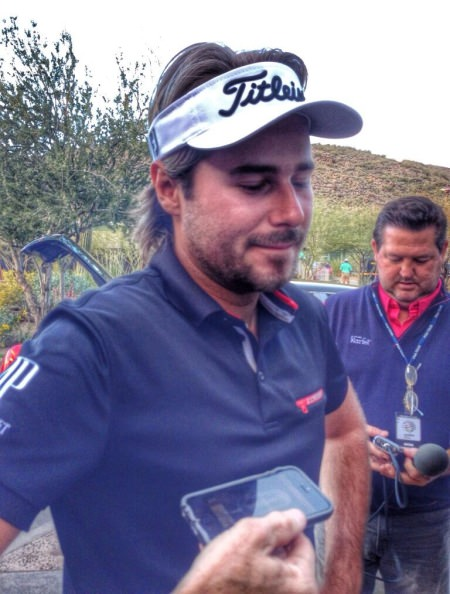 Victor Dubuisson speaks to reporters after his defeat to Jason Day at the 23rd in the final of the WGC-Accenture Match Play at Dove Mountain.