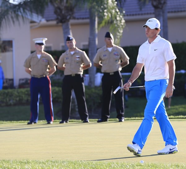 Rory McIlroy hardly noticed the military personnel on the 17th green so engrossed was he in his task. Picture Fran Caffrey  www.golffile.ie