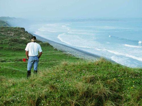 Greg Norman contemplates the dunes during a design visit. Picture via  doonbeglodge.com