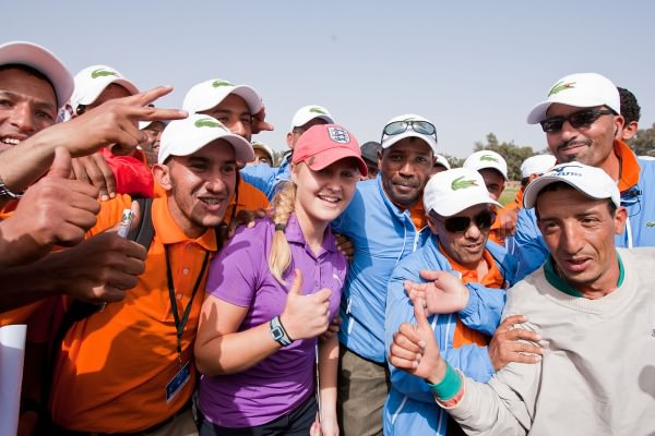 Charley Hull celebrates her maiden Ladies European Tour win with the caddies in Morocco. Picture © Ladies European Tour/Tristan Jones