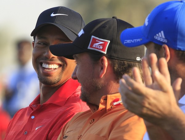 Tiger Woods and Graeme McDowell share a joke at the prize giving following the HSBC Golf Championship at the Abu Dhabi Golf Club, United Arab Emirates, 29th January 2012. Photo Eoin Clarke/ www.golffile.ie