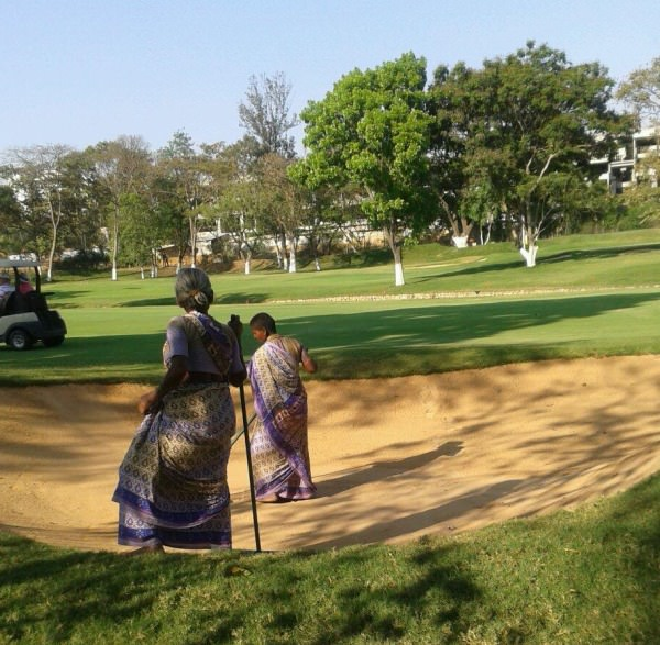 Raking the bunkers in Bangalore. Picture via  @DermotMcElroy