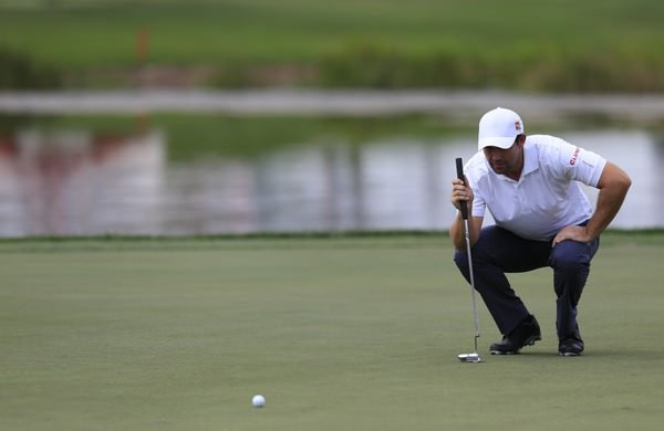 Pádraig Harrington lines up a putt during the recent Honda Classic. Picture Fran Caffrey:  www.golffile.ie