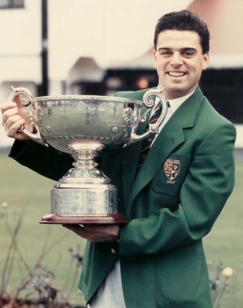 Paul McGinley played all his amateur golf at Grange. (Above) At the club with the 1989 Irish Amateur Close trophy following his victory over Niall Goulding at Rosses Point.